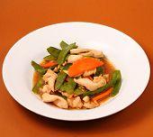 stock photo of stir fry  - chicken stir fry thai style on a brown background - JPG