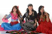 foto of gypsy  - Three gypsy women posing in traditional outfits - JPG