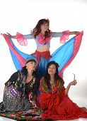 stock photo of gypsy  - Three gypsy women posing in traditional outfits - JPG