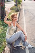 picture of waving hands  - Lovely sportswoman waving somebody with her hand - JPG