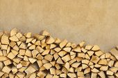 picture of firewood  - And chop firewood stacked against the wall - JPG