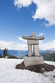 Whistler Peak Inukshuk With Snow And Mountains Vertical