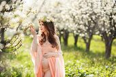 pic of night-blooming  - Young beautiful pregnant woman - JPG
