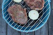 picture of pork cutlet  - Pork cutlets with spring onions on barbeque - JPG