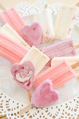 image of popsicle  - Variety of frozen fruit popsicles on vintage plate - JPG