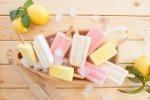 stock photo of popsicle  - Variety of frozen fruit popsicles in little wooden boat - JPG