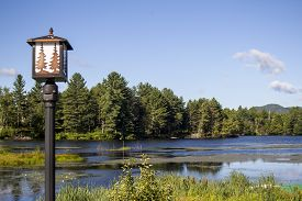 stock photo of lamp post  - Lamp Post on the edge of a Mountain Lake - JPG