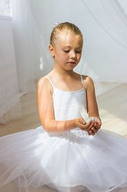 stock photo of fairy tail  - Little cute ballerina with white bird - JPG