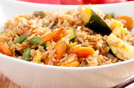 stock photo of stir fry  - stir fry vegetarian vegetables with brown rice and asian sauces - JPG